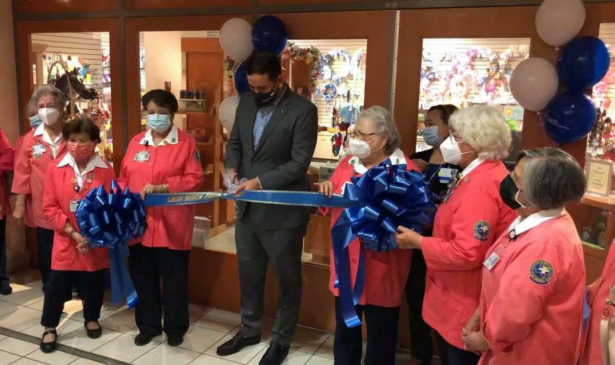 Laredo Medical Center Chief Executive Officer Jorge CEO Jorge Leal cuts the ribbon as the hospital's gift shop reopens and volunteers are welcomed back for the first time on Wednesday.