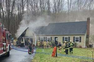 Firefighters respond to a house fire on Bradley Lane in Newtown on Wednesday, April 21, 2021. The fire marshal said the fire was caused by a lightening strike.