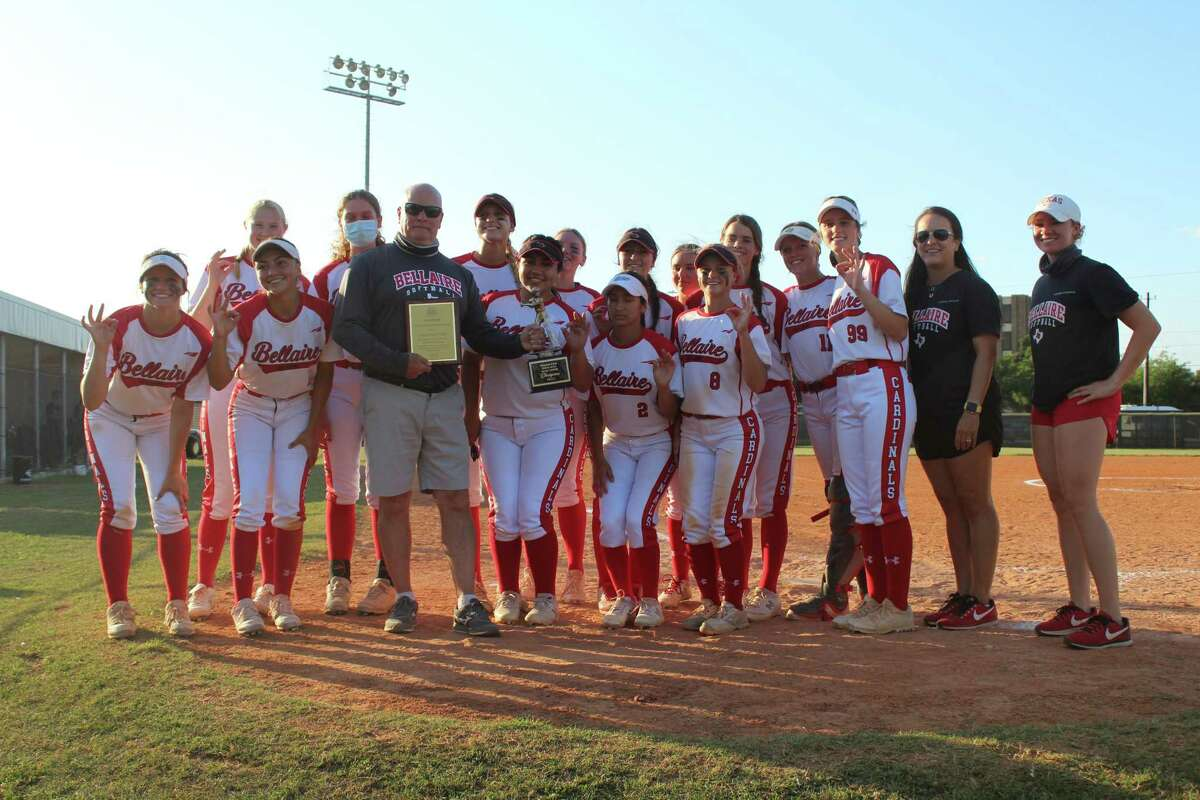 Bellaire softball coach Brien Tuffly with his Lady Cardinals celebrating his 600th win and District 18-6A title.