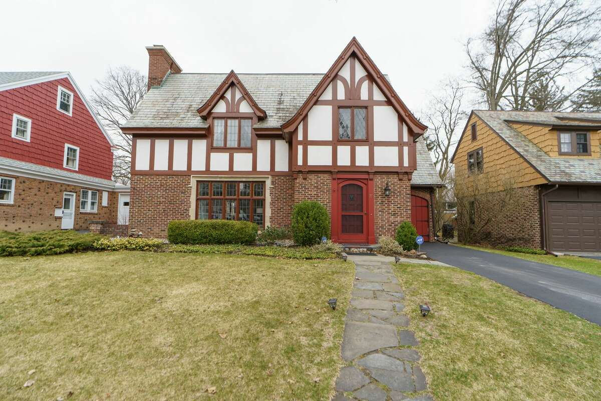 Beautiful Tudor style home two blocks from Buckingham Pond. Built in 1933. Three bedrooms, two and a half baths, 2,033 square feet. It has half-cladding and stucco on the upper half, brick on the lower. Inside are sweet details like exposed beams with decorative carving, moulding in a frieze pattern at the top of the dining room walls and cathedral-arch doorways. Taxes: $9,779. List price: $415,000. Contact listing agent Julia Rosen of Berkshire Hathaway HS Blake at 518-859-7725.