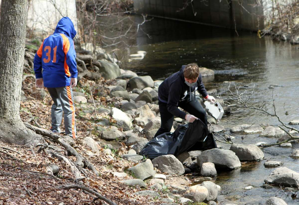 To celebrate Earth Day, Big Rapids Middle School students and teachers spent Thursday morning, and into the early afternoon, cleaning up some of the community's parks. One of those parks included Mitchell Creek Park.