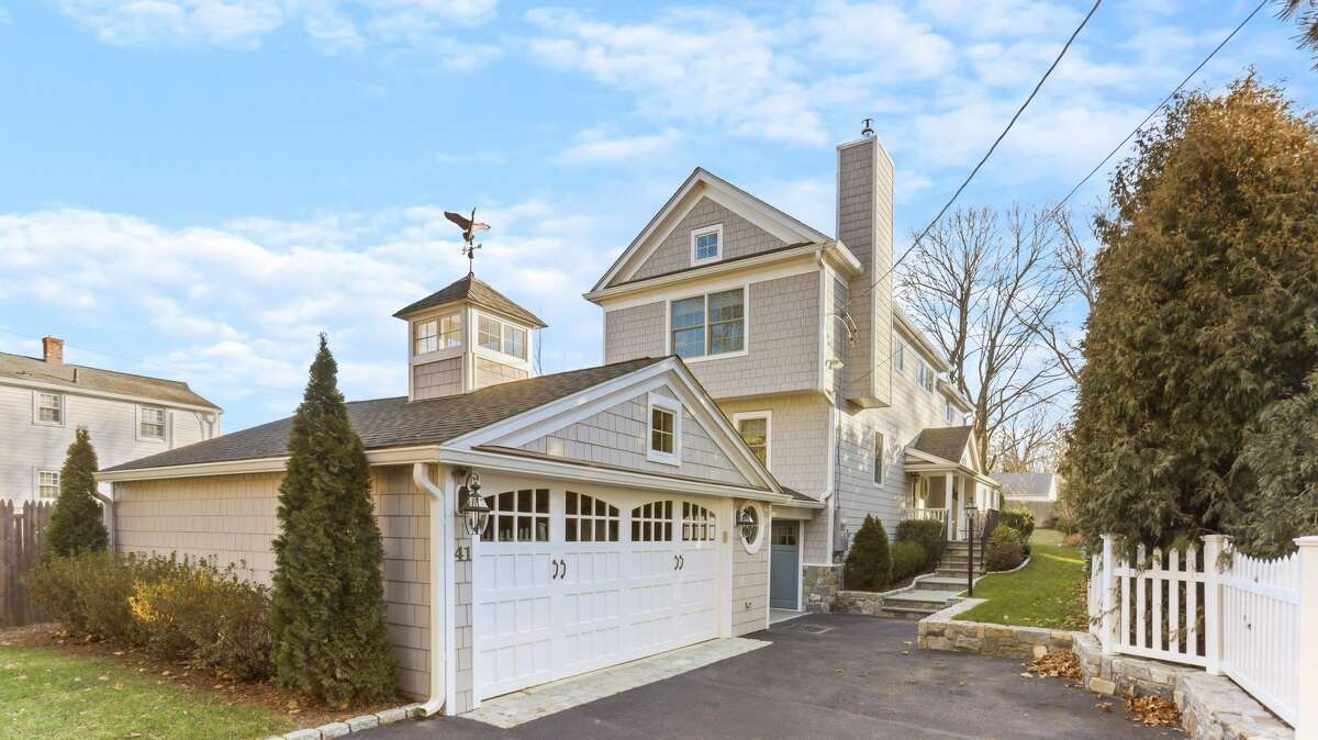"""Price: $1,655,0004 bedrooms, 3.5 bathrooms, 2,326 square feet In addition to spray foam insulation and smart Nest thermostats to help curb heating use, this Greenwich home features a """"new Tesla solar system with backup power,"""" according to the listing. These low-profile panels can cost up to $32,800, depending on the energy usage of the home. View listing"""