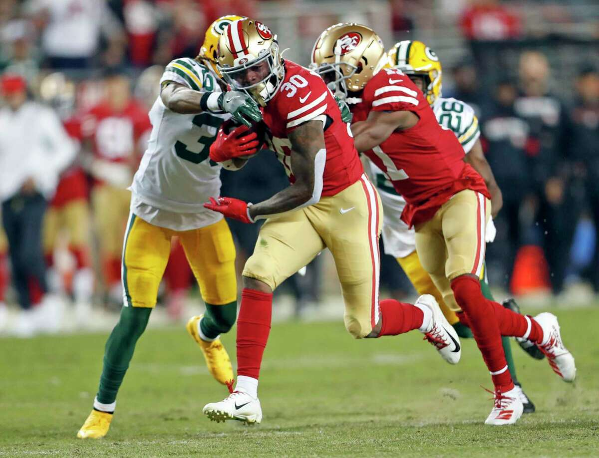 San Francisco 49ers' Jeff Wilson. Jr. rushes for 25 yards in 1st quarter against Green Bay Packers during NFL game at Levi's Stadium in Santa Clara, Calif., on Sunday, November 24, 2019.