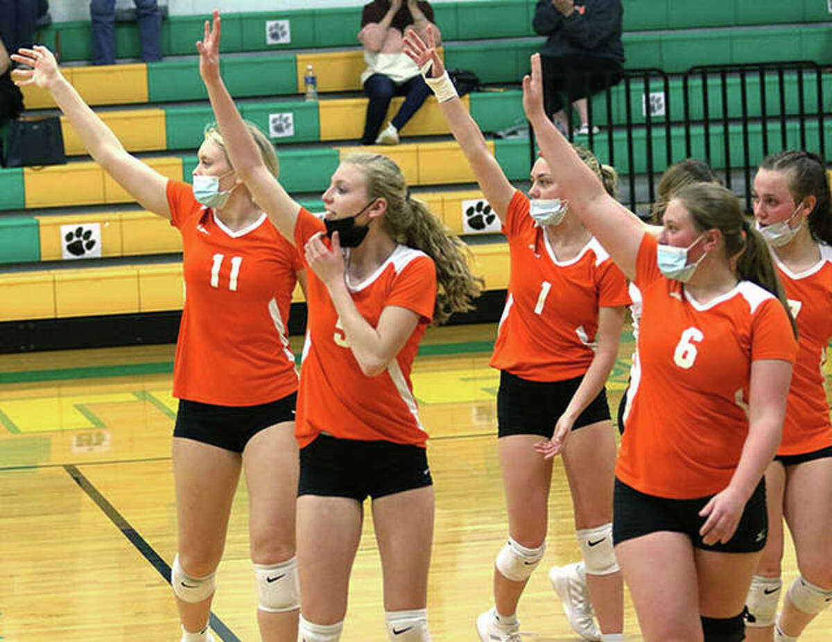 Greenfield's (from left) Kersty Gibbs, Alexis Pohlman, Jessa Vetter, Kaitlyn Foiles and Baylee Bilbruck acknowledge Raymond Lincolnwood after the Tigers' three-set win April 12 in Palmyra.