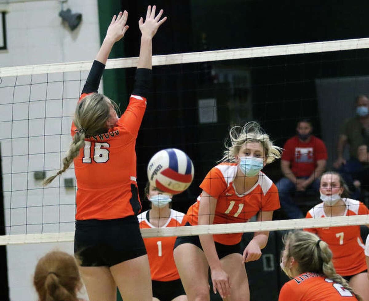 Greenfield's Kersty Gibbs (11) watches her attack go down for a kill during a match against Raymond Lincolnwood on April 12 in Palmyra.