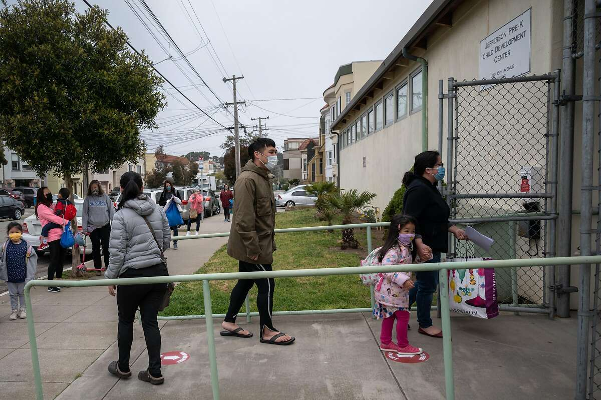 William and Joanna Luong drop off their daughter Evelyn for her first day of school at Jefferson Early Education School in San Francisco.