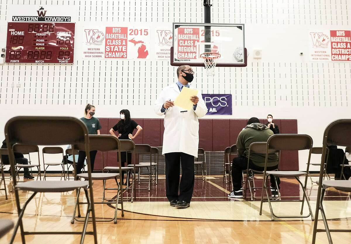 DETROIT, MI - APRIL 12: Medical staff watch and advise walk-in patients who received their COVID-19 vaccination at a pop-up clinic at Western International High School on April 12, 2021 in Detroit, Michigan. The state of Michigan has seen an explosion of COVID-19 cases despite a massive effort to roll out vaccines. Pop-up clinics in various communities are one of the ways the state government is trying to get the surge under control. (Photo by Matthew Hatcher/Getty Images)