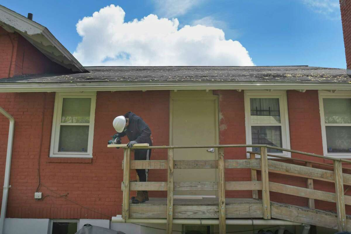 Tiger Griffin cuts two-by-fours as he and other men and women in the Help Yourself Win Foundation program work rehabbing the Bethel AME Church on Thursday, April 22, 2021, in Schenectady, N.Y. (Paul Buckowski/Times Union)