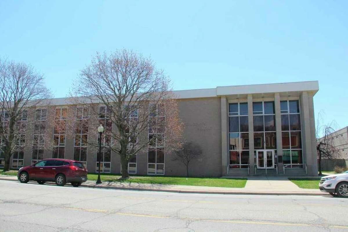 The Huron County Building. The building currently does not have a person monitoring people entering and leaving it for COVID-19, instead having them use a leased scanner themselves. (Tribune File Photo)