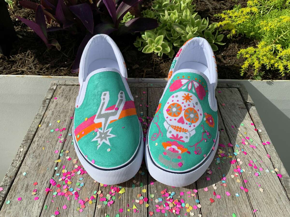 After getting more experience painting through the early days of the COVID-19 pandemic, Jordan Geelhoed created some puro as heck kicks. Using the iconic Spurs Fiesta colors, the San Antonio native honored the Fiesta we know and love as well as the city's Latinx population through vibrant symbols and festive drawings.