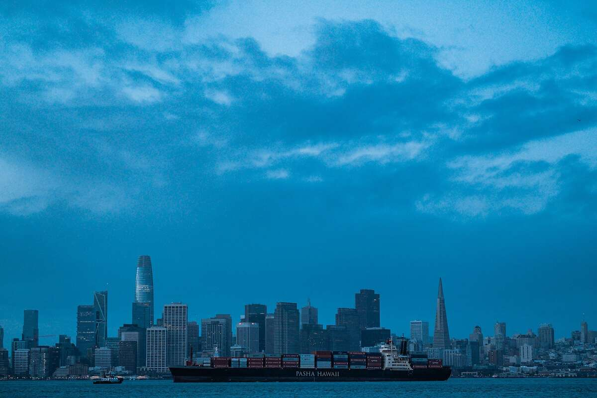 A file photo of light cloud cover over the San Francisco skyline as seen form Treasure Island in San Francisco. Aburst of rain is expected to drench the Bay Area this weekend, bringing much-needed moisture to a parched region.