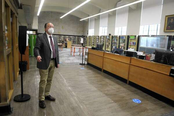Assistant City Librarian John Soltis speaks during an interview in the main reading room of the Burroughs-Saden main branch library in downtown Bridgeport, Conn. April 21, 2021. The library will reopen to the public on Monday.
