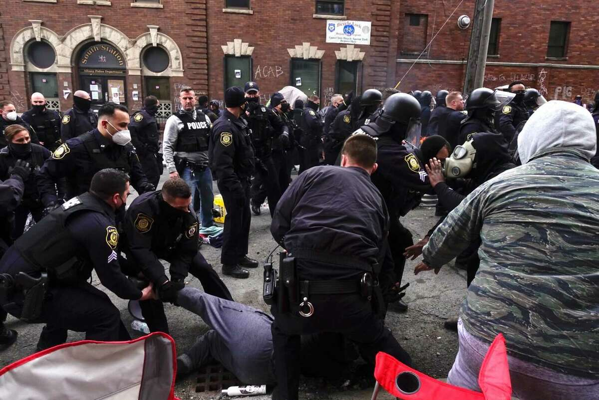 Albany police clashed with anti-brutality protesters Thursday as officers cleared them from an encampment of tents built next to the department's South Station.