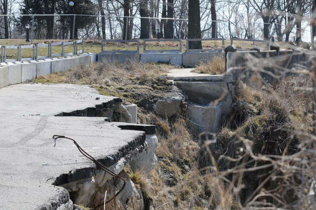 The damaged section of Riverview Drive remains scarred from 2019 floods.