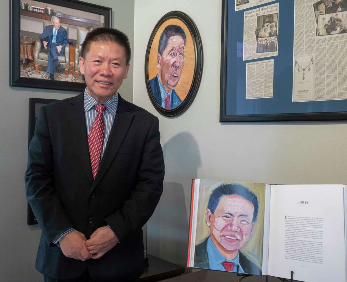 Pastor Bob Fu with the two portraits former President George W. Bush has painted of Fu 04/22/2021 at the China Aid Office Tim Fischer/Reporter-Telegram