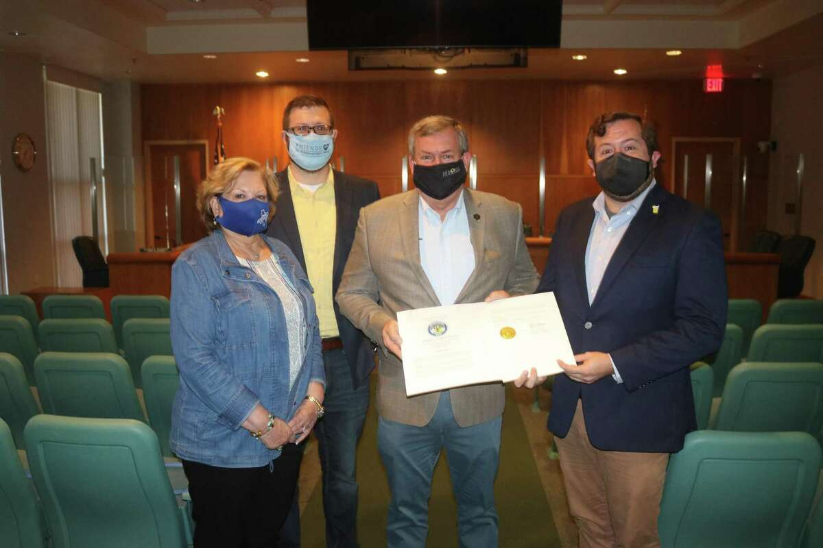 Formally ushering in Friendswood's Lemonade Day on May 1 with a proclamation are Friendswood Chamber of Commerce CEO Carol Marcantel, Jim Foreman, Mayor Mike Foreman and Jack Foreman.