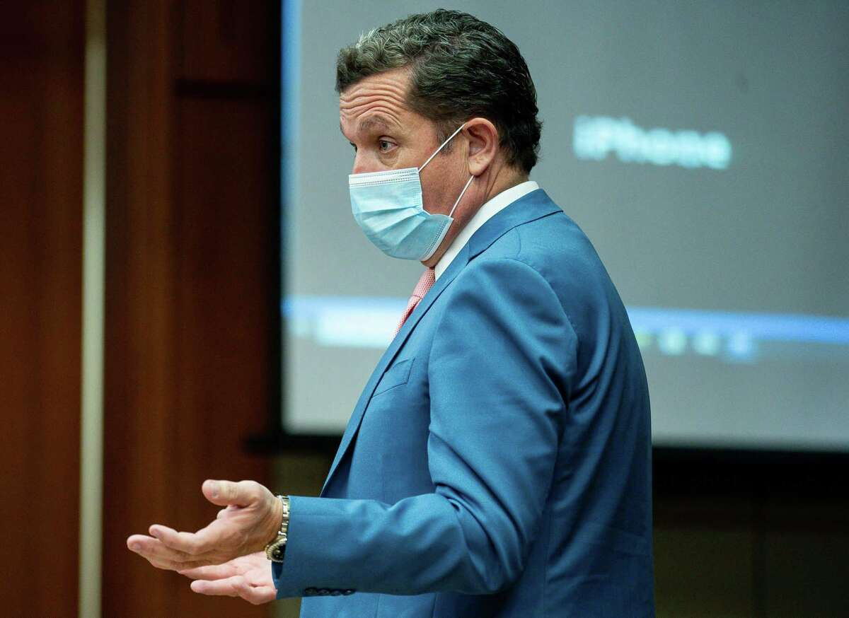 Plaintiff's attorney Tony Buzbee talks to defense attorney Rusty Hardin during a hearing in the sexual assault case against Houston Texans quarterback Deshaun Watson, at 113th District Court inside Harris County Civil Courthouse on Thursday, April 22, 2021, in Houston.