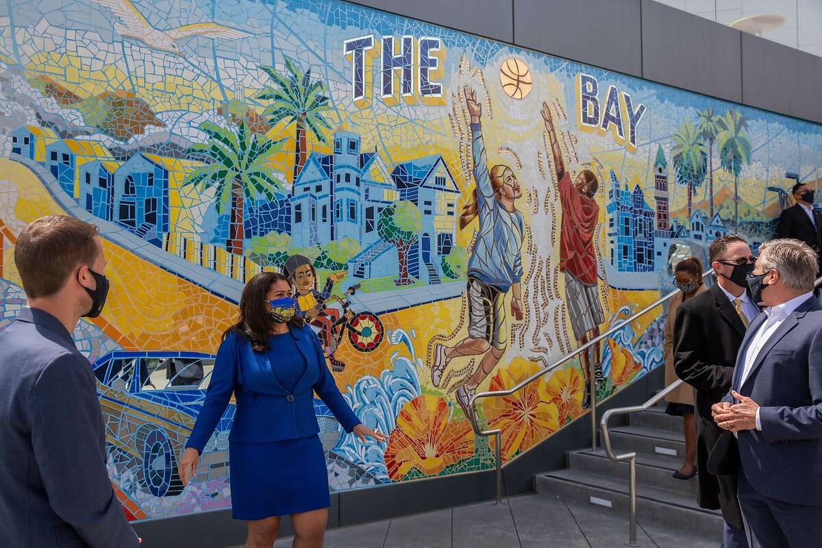 Mayor London Breed tours Chase Center with Golden State Warriors chief revenue officer Brandon Schneider (left) and Warriors president Rick Welts (right).