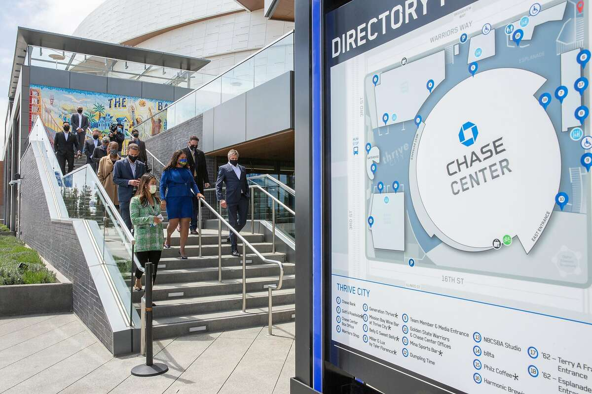Mayor London Breed (in blue) tours Chase Center with Golden State Warriors executives.