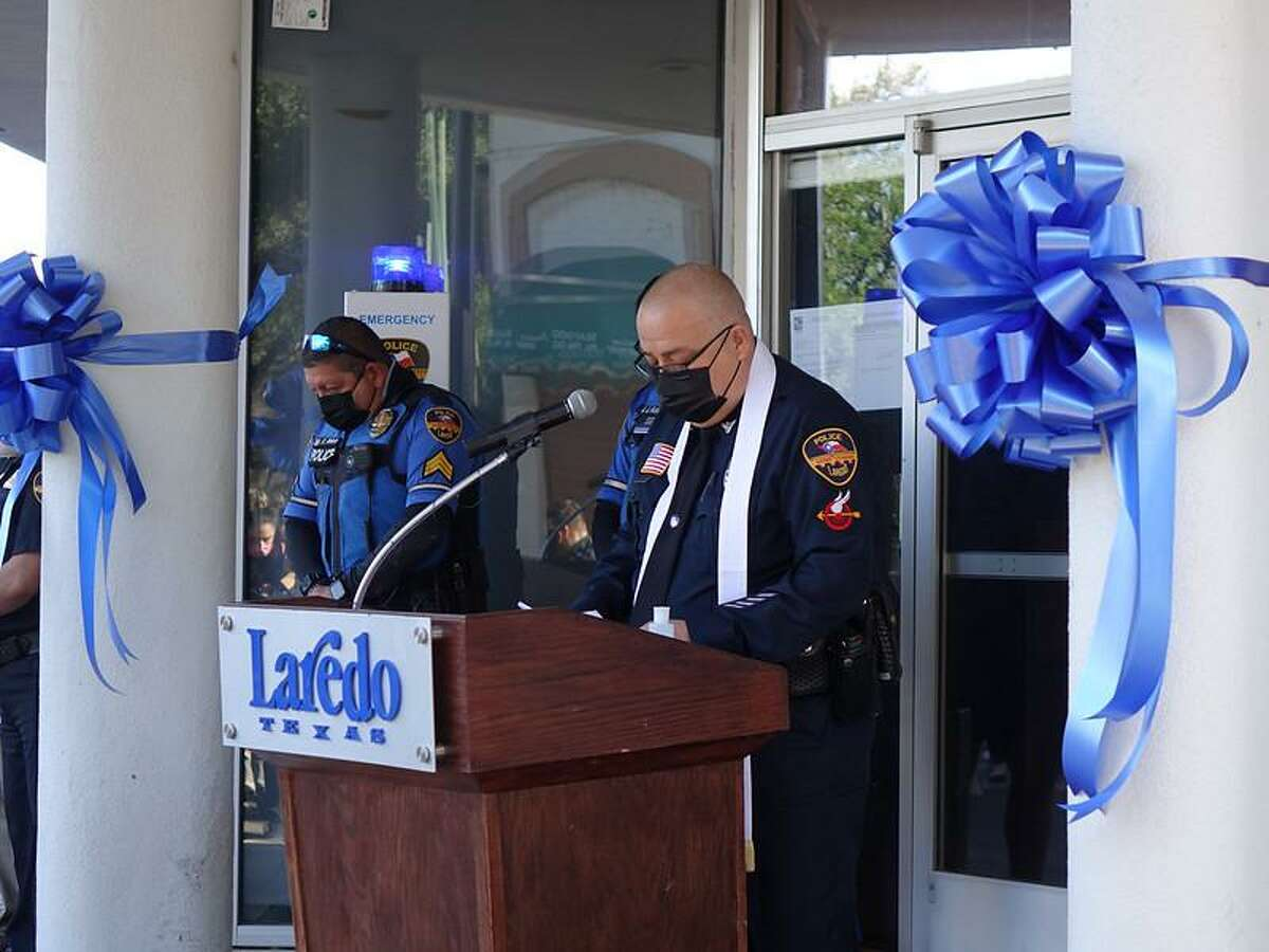 Laredo Police Officer Luis E. Raines does the invocation on April 20 during the ribbon-cutting ceremony for the downtown police substation.
