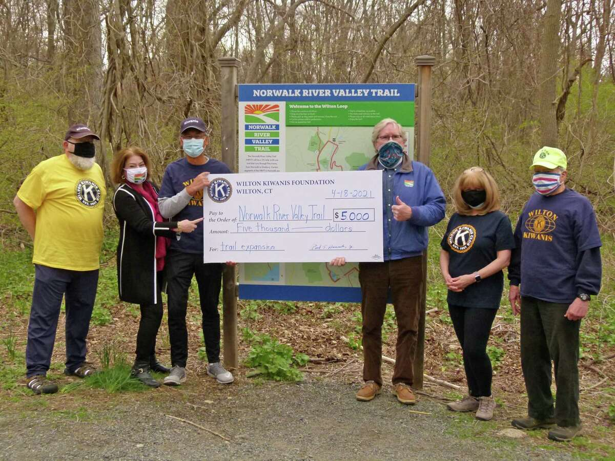 The Wilton Kiwanis Club presented a check for $5,000 for the completion of the Norwalk River Valley Trail in town.