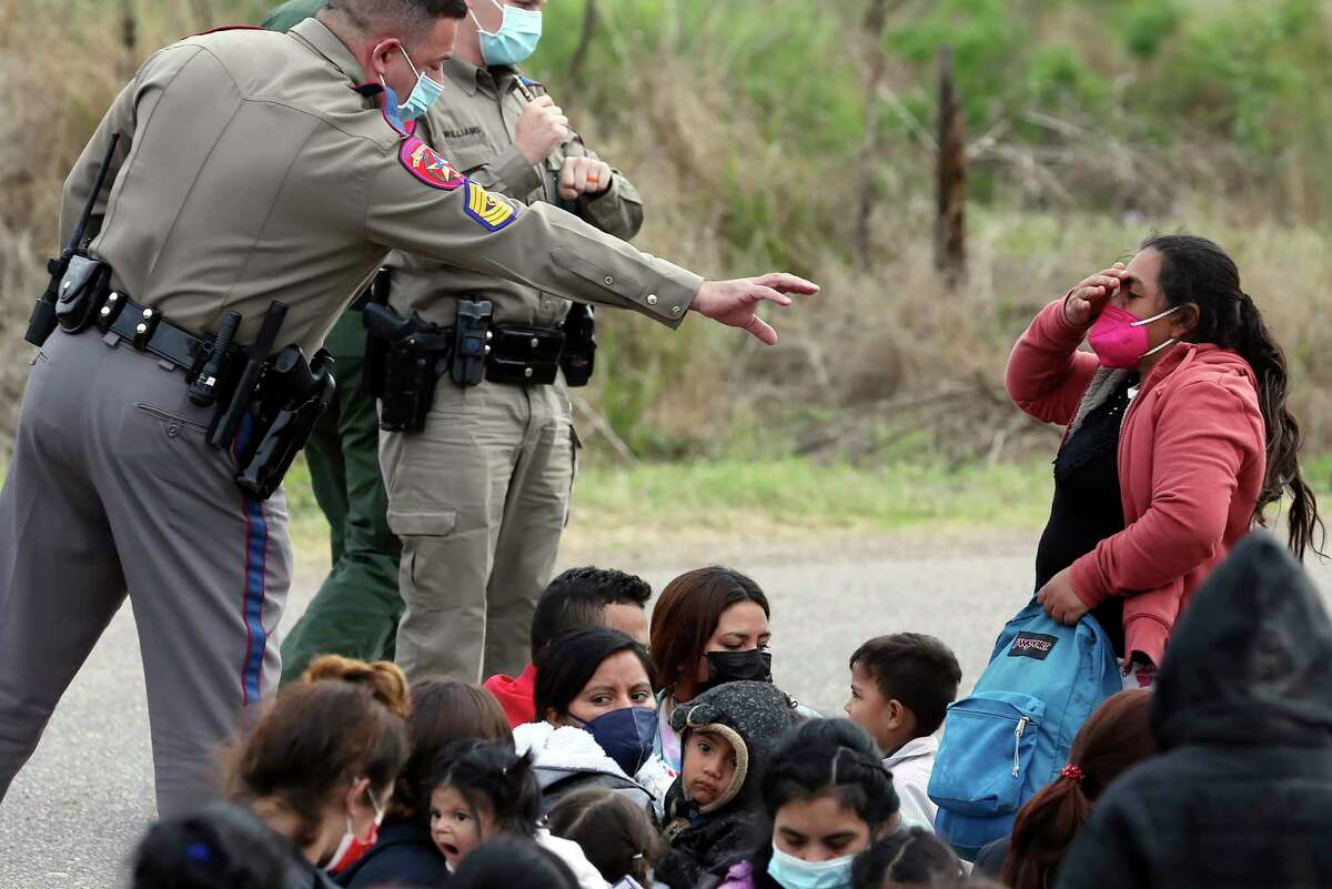 Texas Department of Public Safety troopers help in the detention of a group of around 40 migrants, some unaccompanied minors, west of La Joya, Texas, Friday, April 2, 2021.