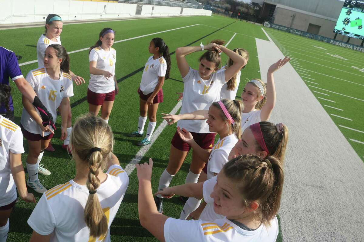 The Deer Park varsity soccer team huddles before a district game this past season. In the final Texas Girls Coaches Association state soccer poll, they were given honorable mention accolades for their accomplishments.