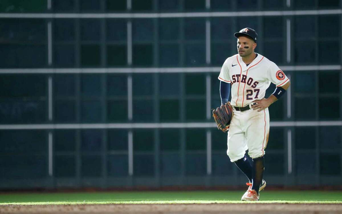 Houston Astros second baseman Jose Altuve (27) on the field during the ninth inning of an MLB baseball game at Minute Maid Park, in Houston, Saturday, April 10, 2021.