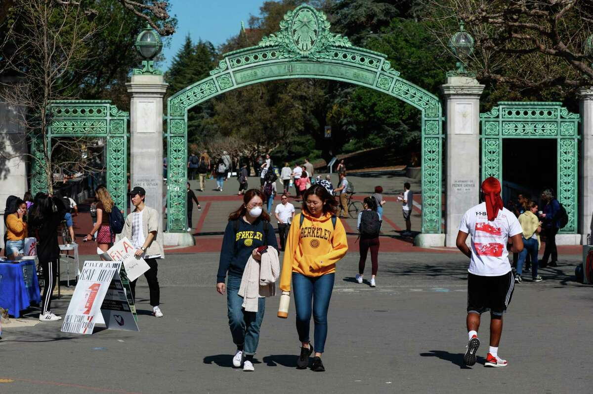 Students walk on the UC Berkeley campus in March 2020. UC Berkeley was recently named the nation's top college by Forbes.
