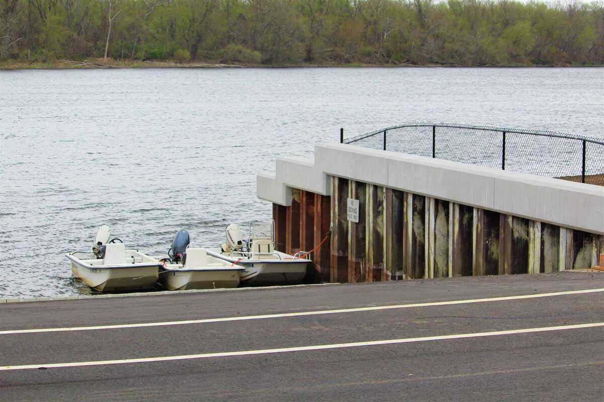 The retaining wall at the Harbor Park fishing dock in Middletown is being reinforced with concrete at the Connecticut River.