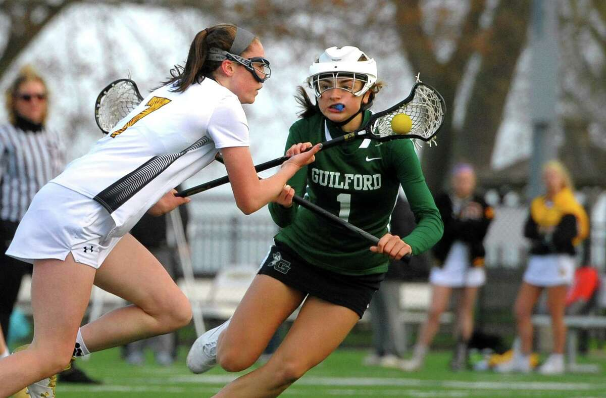 Guilford's Maddie Epke (1) tracks Hand's Reilly Dolan (7) as she drives towards the goal during a game in 2019.