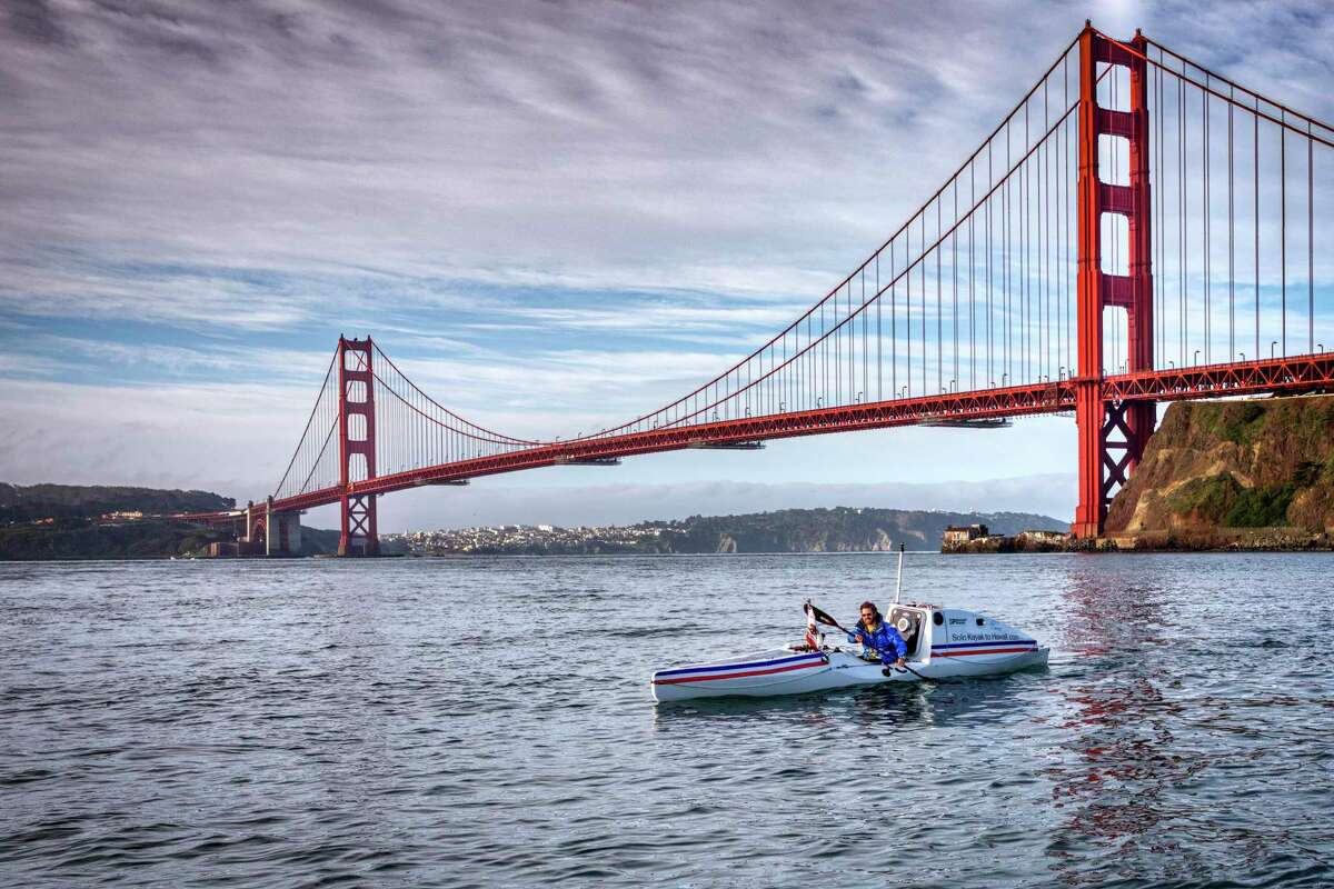Cyril Derreumaux paddles outside the Golden Gate Bridge during a training session this month.