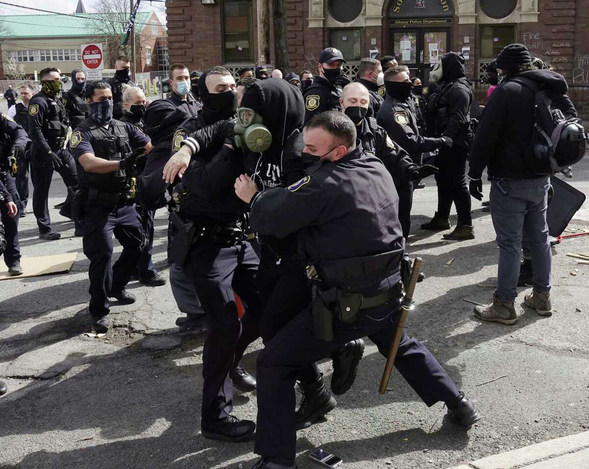 Albany Police move in to clear out protesters from in front of the South Station on Thursday, April 22, 2021, in Albany, N.Y. (Paul Buckowski/Times Union)