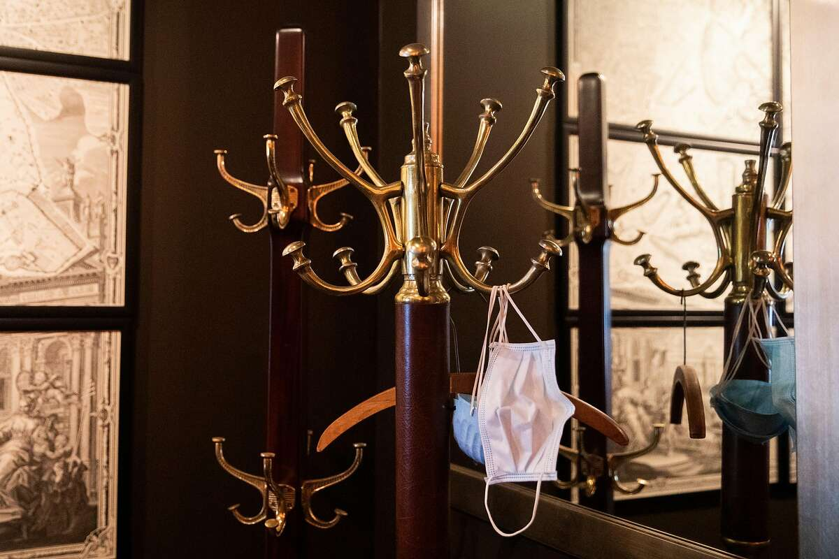 Masks hang from a coatrack at Acquerello. Chef Suzette Gresham says she doesn't have space to continue offering takeout when dine-in guests come back.