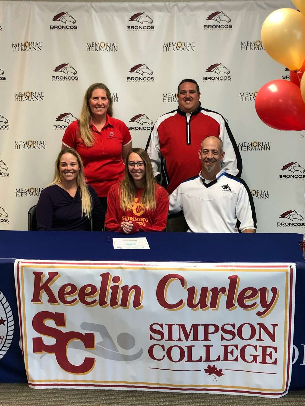 Keelin Curley of Bay Area Christian High School has signed a national swimming letter of intent with Simpson College. Shown are (bottom row) Keelin Curley flanked by her parents, Su and Eric, and (top row) BAC swim coach Katherine Farland and BAC athletic director Kyle Kennedy.