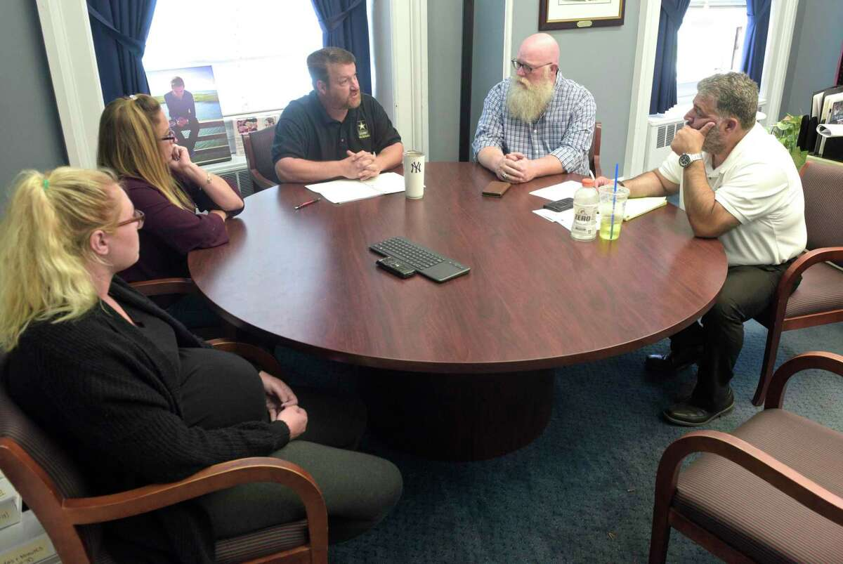 The family of Brian Cody Waldron, who died from a drug overdose in August of 2019, meet with Mayor Pete Bass and State Representative Bill Buckbee in the mayors office on Tuesday. Makayla Showalter, fiancé, left, Mother Tracey Morrissey and step-father Tony Morrissey. August 27, 2019, in New Milford, Conn.