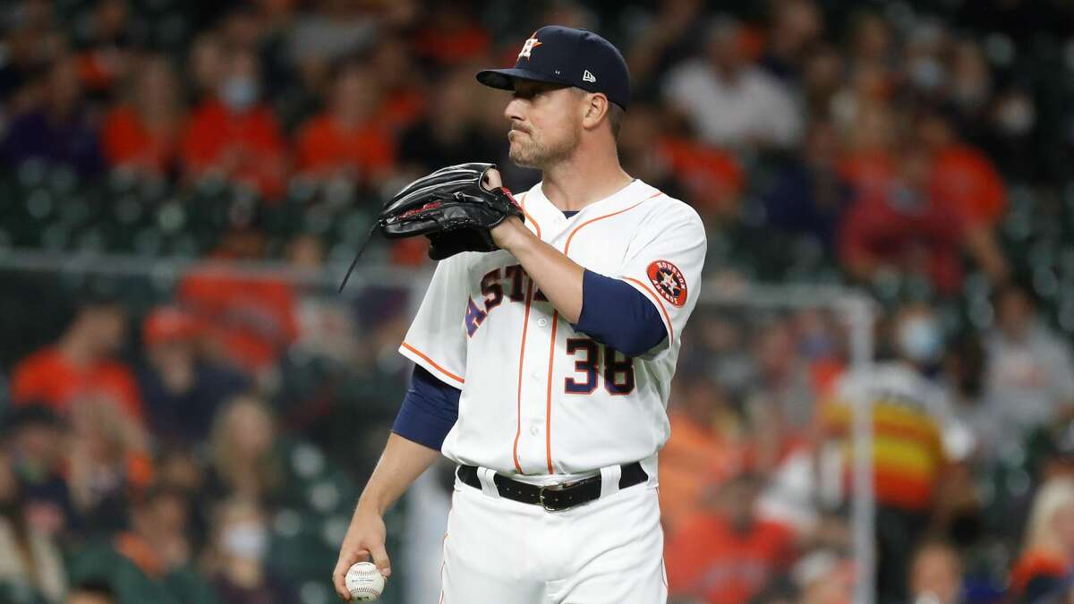 Houston Astros relief pitcher Joe Smith (38) reacts after Detroit Tigers Jeimer Candelario's RBI single during the fourth inning of an MLB baseball game at Minute Maid Park, in Houston, Wednesday, April 14, 2021.