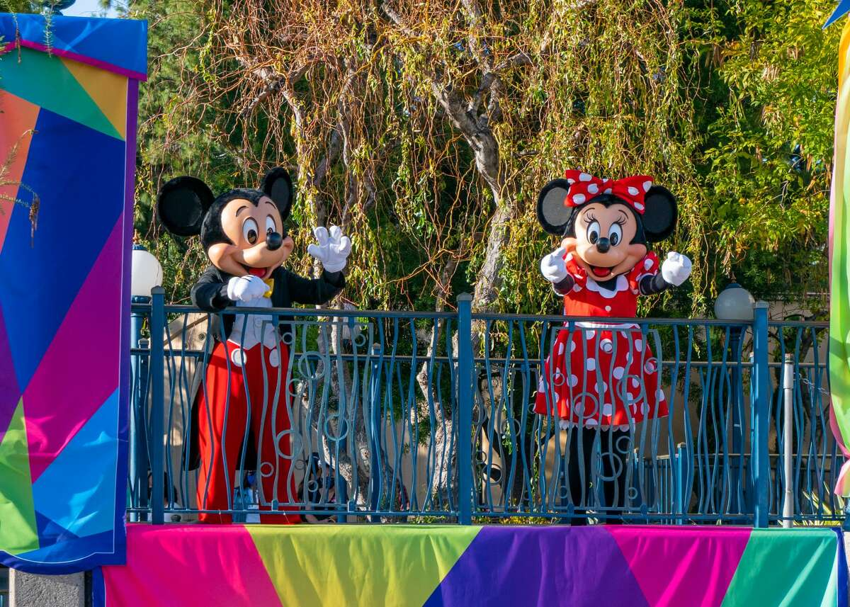 Mickey and Minnie waving to park-goers at Disney's California Adventure Park on April 11, 2021