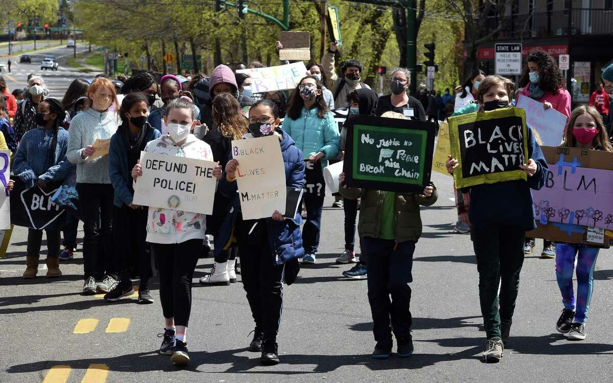 Students from Elm City Montessori School march for the Black Lives Matter movement on Whalley Avenue in New Haven on April 22, 2021.