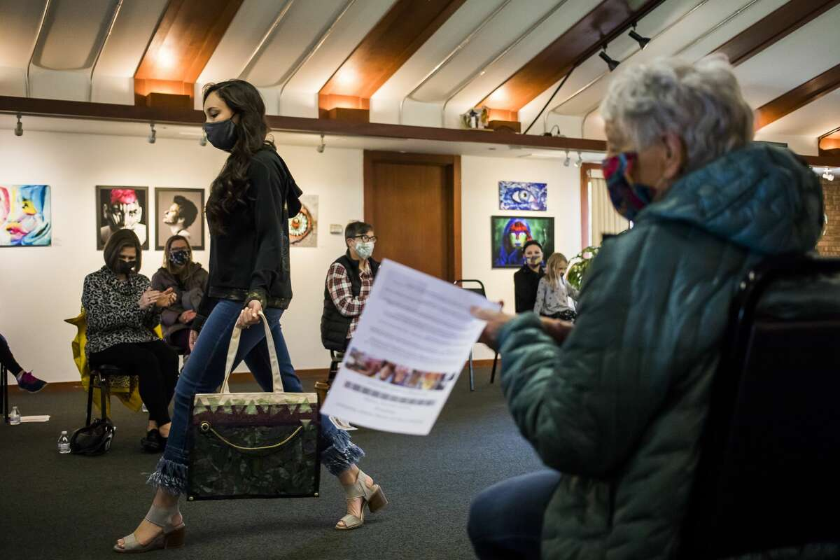 Ari Lopez models an ensemble during a spring fashion fundraiser for the Express Yourself Artshop, hosted in partnership with Botanica Modern Market, Thursday, April 22, 2021 at Creative 360 in Midland. (Katy Kildee/kkildee@mdn.net)