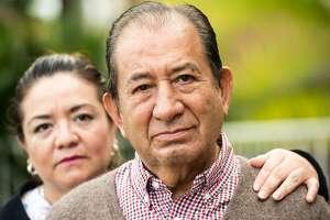 Smiling, Caring, hispanic nurse and elderly senior patient in nursing home
