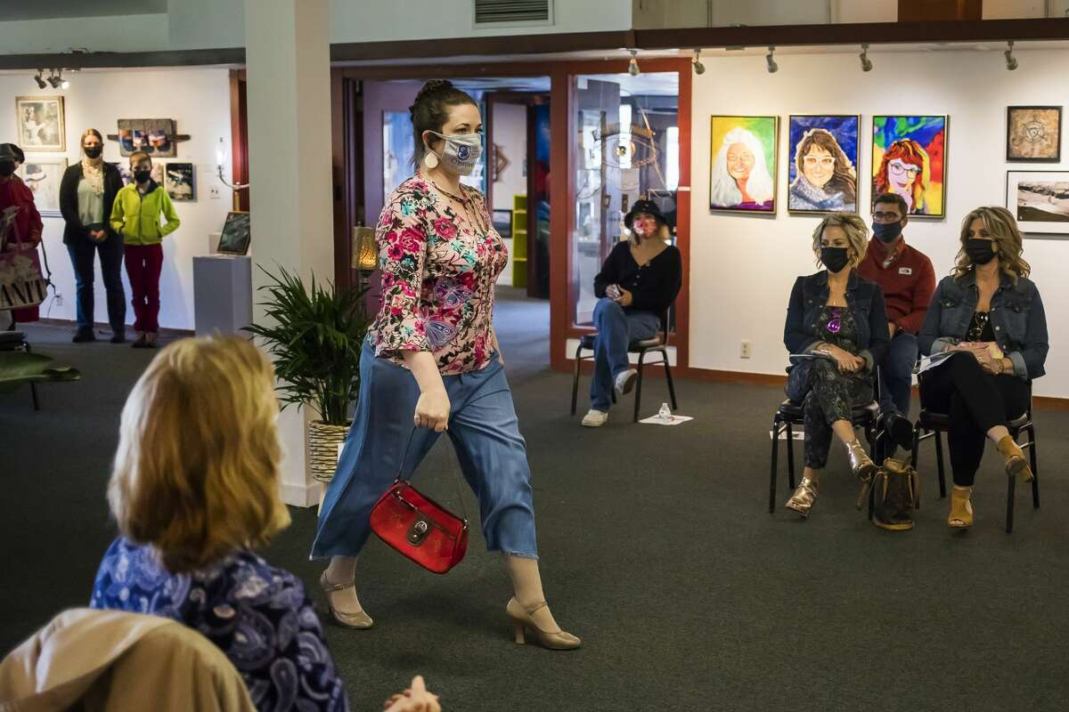 Laura Brigham models an ensemble during a spring fashion fundraiser for the Express Yourself Artshop, hosted in partnership with Botanica Modern Market, Thursday, April 22, 2021 at Creative 360 in Midland. (Katy Kildee/kkildee@mdn.net)