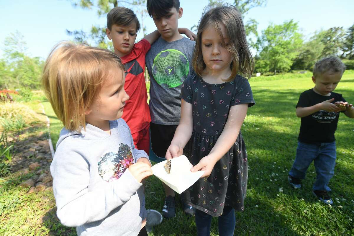 Mia Smith (left) and Vivian Treadway wait for their butterfly to take flight as they join in the butterfly release on the opening day of Shangri La's Eco Fest, celebrating Earth Day. The event continues through Saturday. Photo made Thursday, April 22, 2021 Kim Brent/The Enterprise