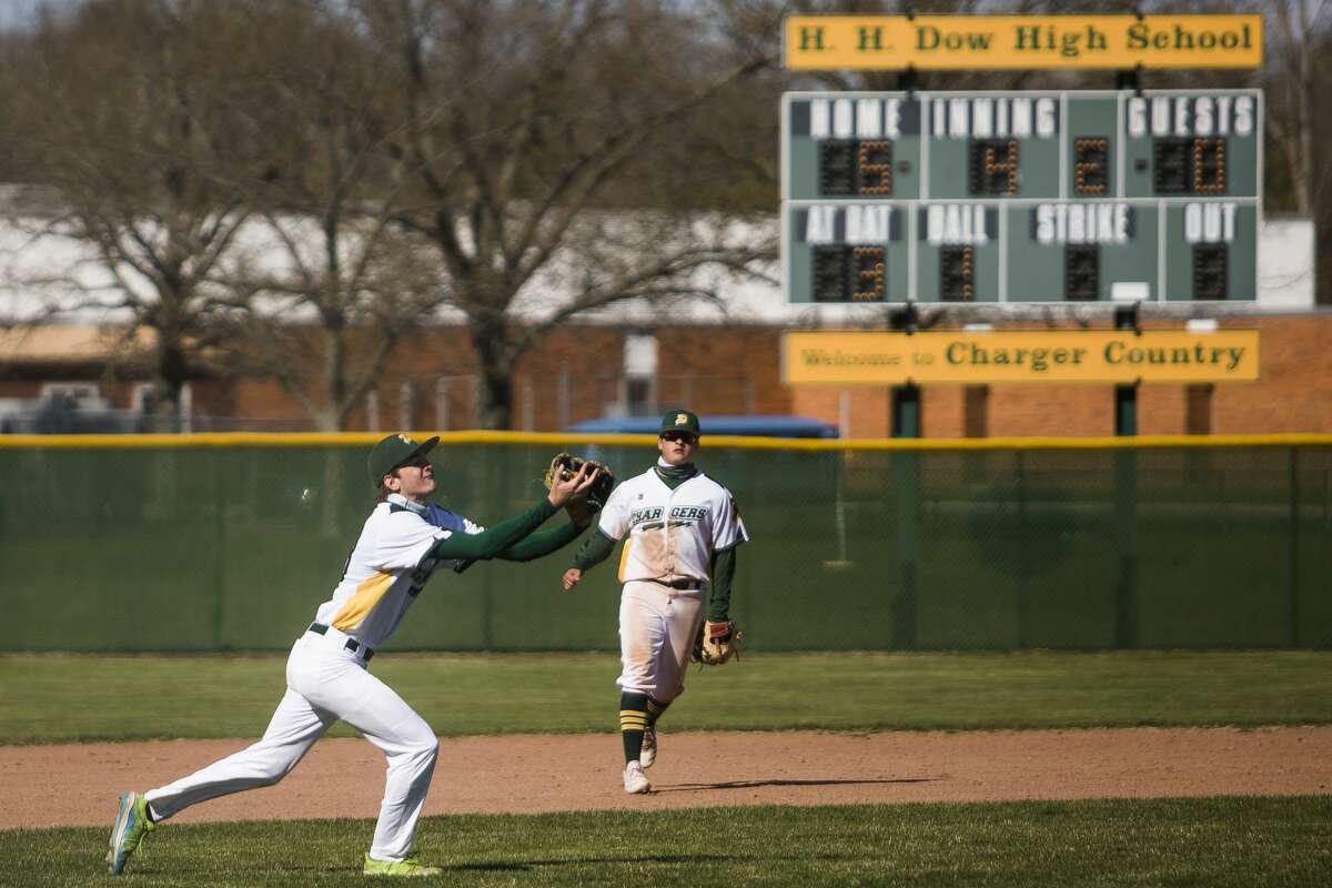 Dow's John Szajenko catches a fly ball during the Chargers' game against Flint Powers Thursday, April 22, 2021 at H. H. Dow High School. (Katy Kildee/kkildee@mdn.net)