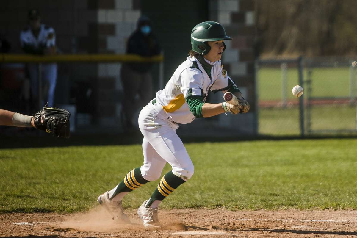 Dow's Nolan Sanders bunts the ball during the Chargers' game against Flint Powers Thursday, April 22, 2021 at H. H. Dow High School. (Katy Kildee/kkildee@mdn.net)