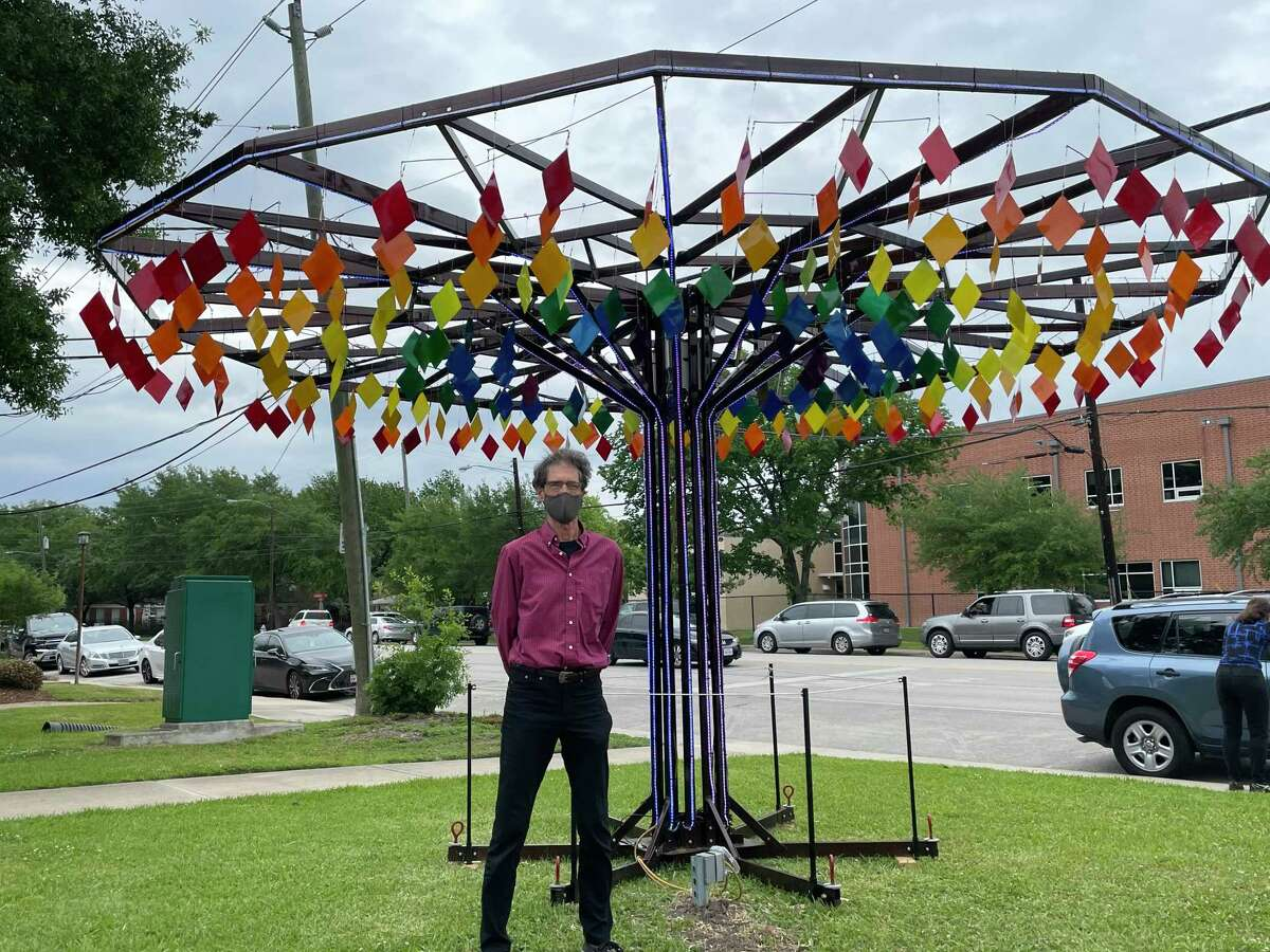 Bellaire resident Paul Robertson poses in front of his art piece Oasis Art Tree following the ribbon cutting ceremony on the afternoon of April 22 for the piece which is now on public display at Loftin Park right next to Bellaire City Hall