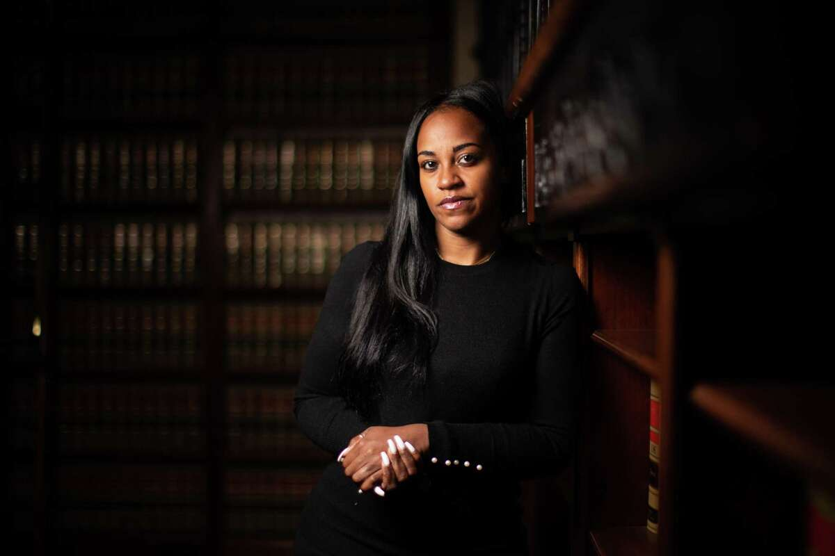 """A portrait of Erica Davis at her lawyer's office on Feb. 10, 2021 in Houston. """"Even though this was a traumatic experience, it is my prayer that when others see me, they see courage,"""" said Davis, who serves on Harris County's board of education and on Precinct 1 Constable Alan Rosen's staff, reported being assaulted at a Massage Heights branch on West Holcombe near the Texas Medical Center in 2019. Davis and her husband are suing the Massage Heights, franchise owner, Asif Hafiz and Wenjin Zhu, also known as James Jefferson, the therapist accused in the attack."""