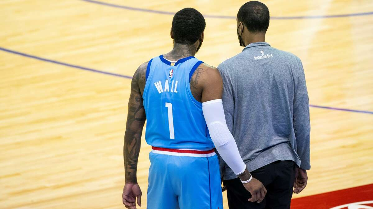 Houston Rockets guard John Wall (1) and Houston Rockets head coach Stephen Silas () talk during the third quarter of an NBA game between the Houston Rockets and Utah Jazz on Wednesday, April 21, 2021, at Toyota Center in Houston.