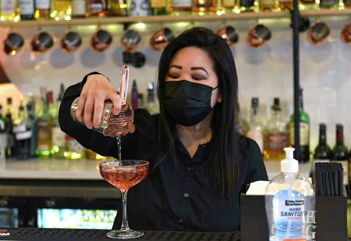Co-owner Mary Phan makes a drink at The Loft @ 205 on Thursday, April 22, 2021 in Albany, N.Y. Mary and her brother Will regularly have to work fill-ins because they can't hire enough staff. (Lori Van Buren/Times Union)