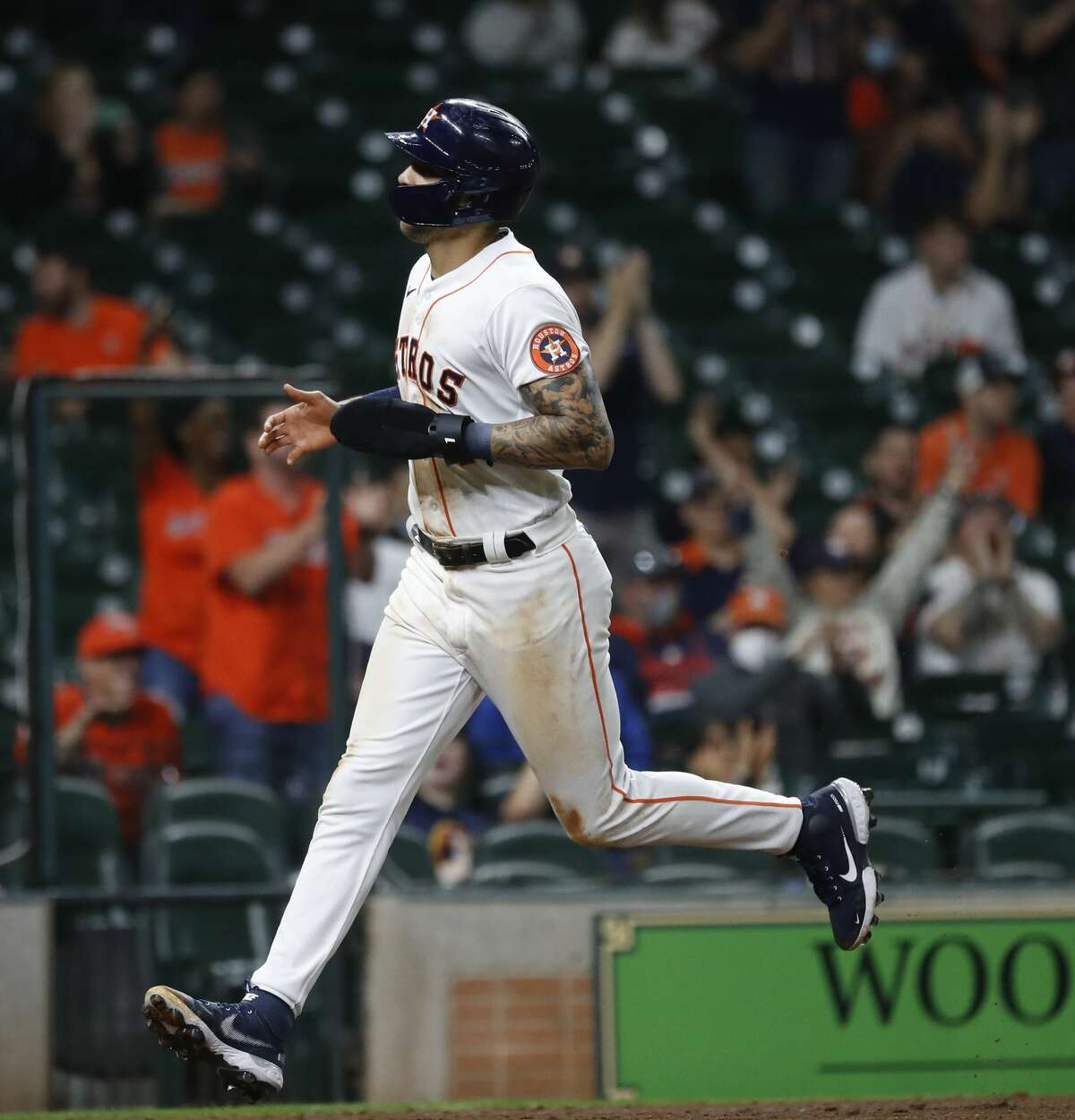 Houston Astros Carlos Correa (1) scores a run on Alex Bregman's single during the fifth inning of an MLB baseball game at Minute Maid Park, Thursday, April 22, 2021, in Houston.